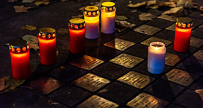 Stolperstein and Candles in loving memory of holocaust Victims